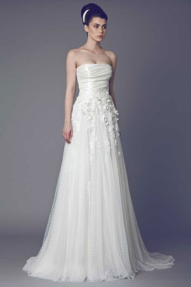Pensée - Strapless Off White gown with draped asymmetrical Satin bust, Point D esprit Tulle skirt and Lace embellishments.