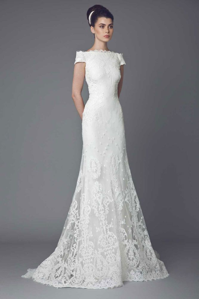 Edelweiss - Lace Off White mermaid cut gown with short sleeves, boat neckline and Lace appliques.
