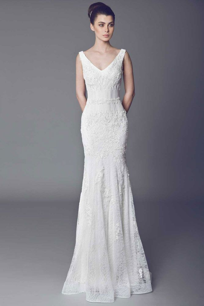 Lavande - Lace Off White mermaid cut gown corseted with wires and embellished with Guipure embroideries.