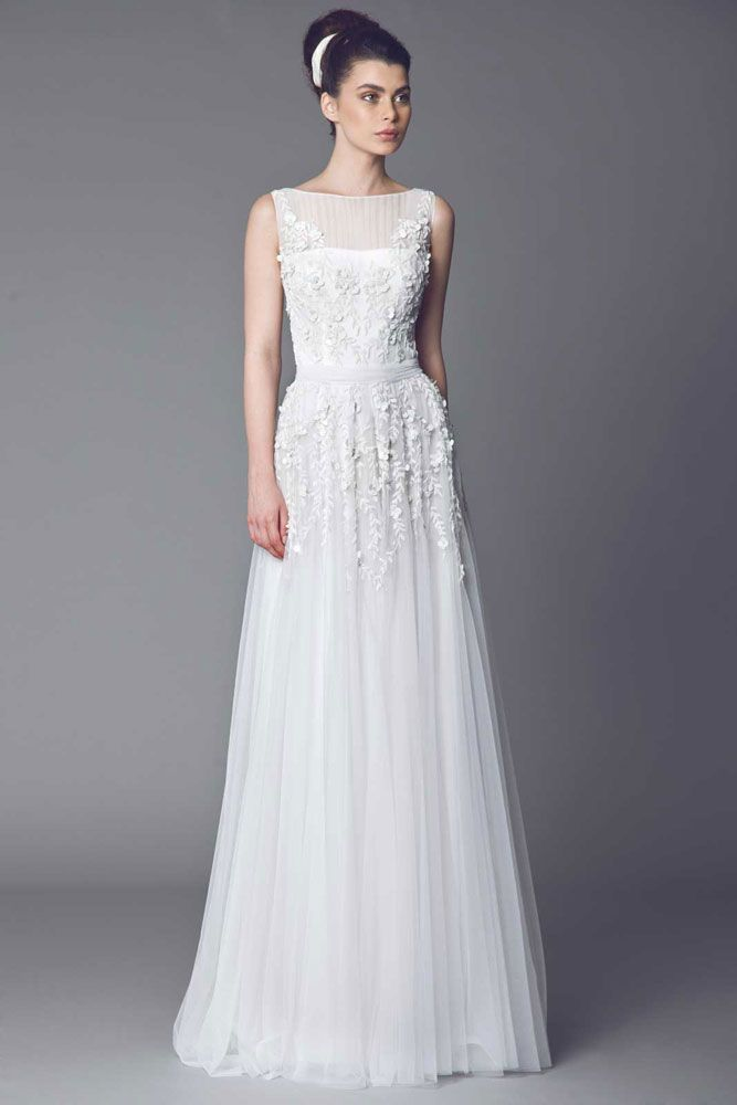 Achillée - Tulle Off White gown embroidered with flower petal appliques, draped belt and a sheer neckline