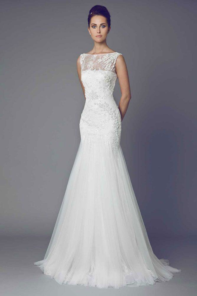 Chrys - Off White mermaid cut gown with embroidered Lace bodice and sheer draped neckline.