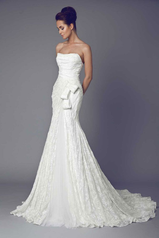 Lysa - Strapless embroidered Silk Gazar gown with a Tulle slit and a bow shape on the hipline.