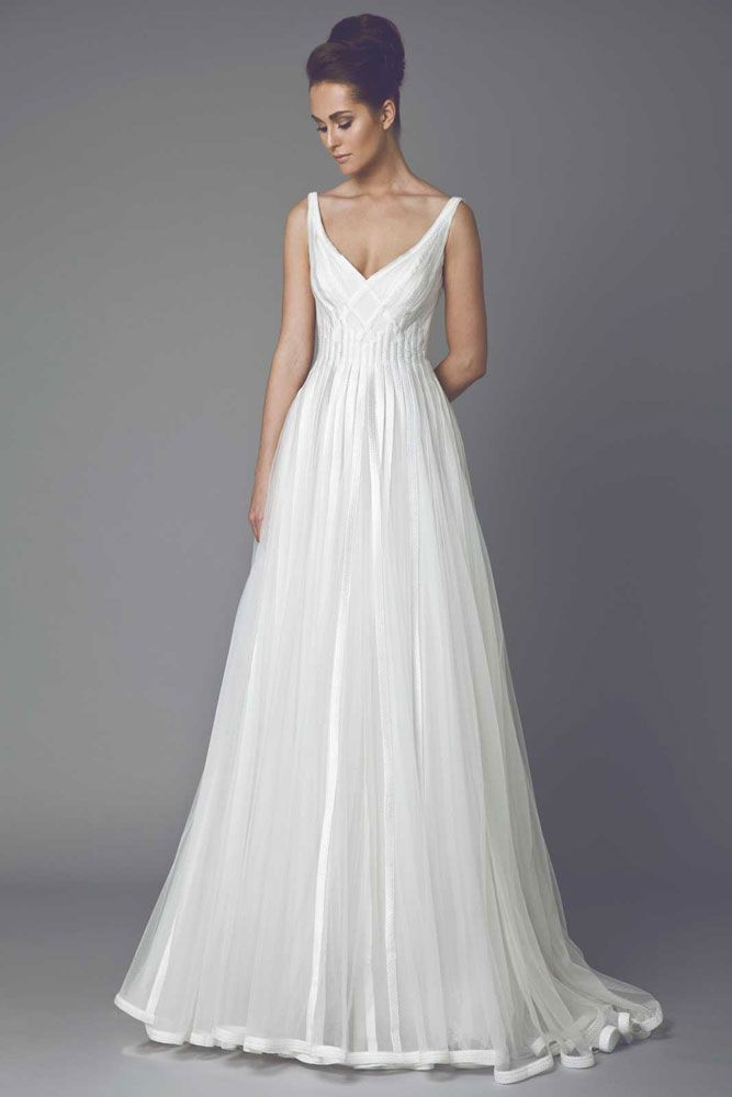 Astragale - Princess cut Off White Tulle gown embellished with interlaced Silk thread lines.