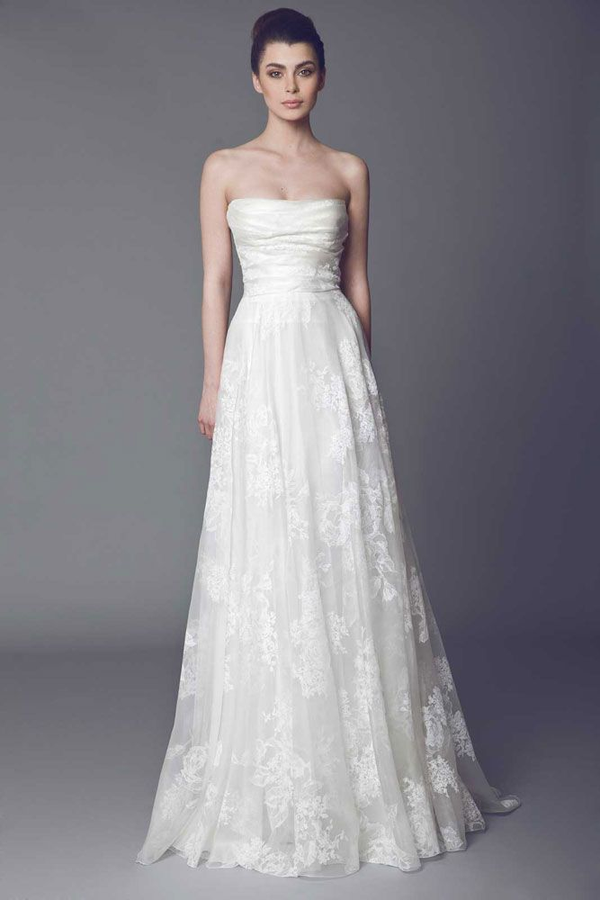 Sabline - Silk Gazar A line strapless Off White gown with asymmetrical draped bust.