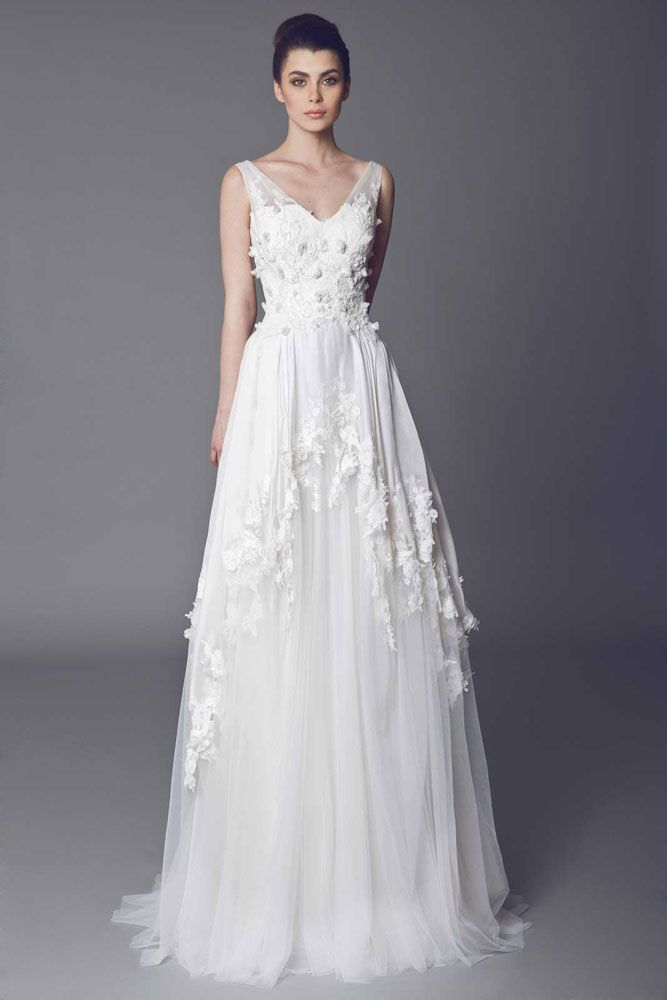 Angélique - Off White V neckline gown with embroidered bodice, Tulle skirt with Organza ruffles and Guipure embellishments.