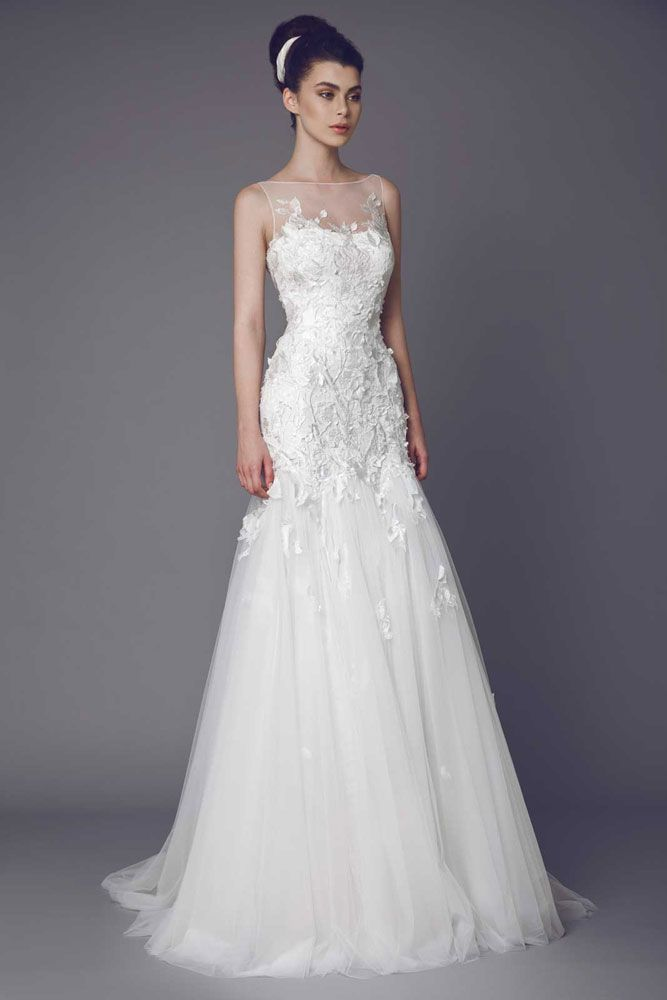 Stellaire - Strapless Off White Lace gown embellished with Guipure appliques, with sheer neckline and Tulle skirt fitted on the hipline.