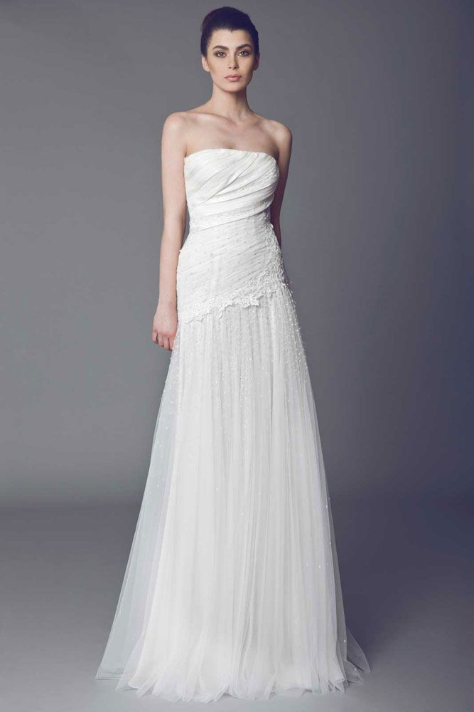 Primevère - Fully embroidered strapless Tulle gown with asymmetrical draped bodice and Guipure embellishments.