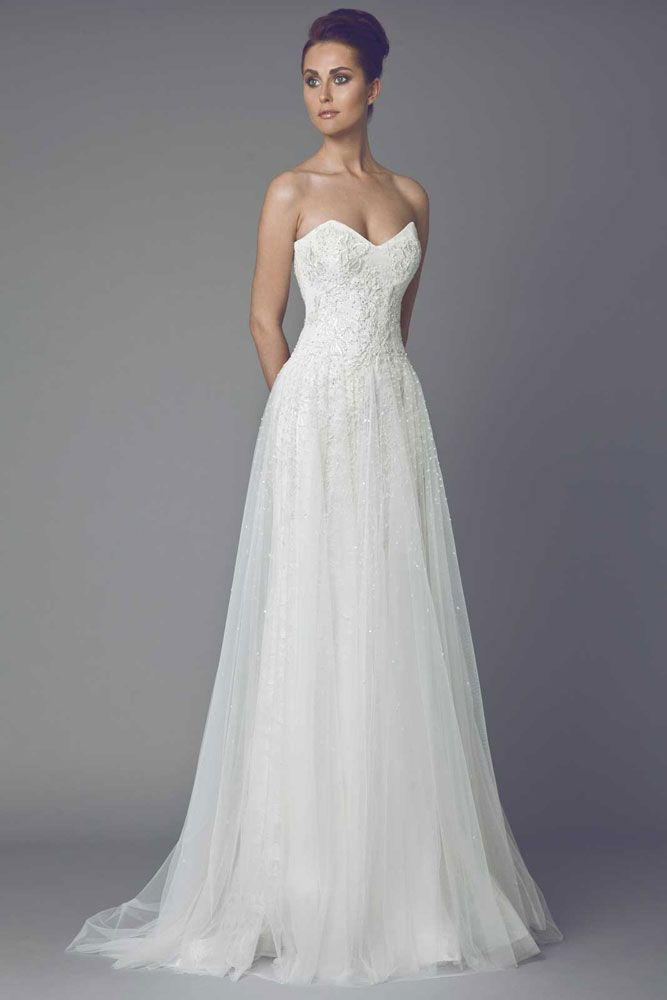 Anémone - Sweetheart shaped strapless Guipure embroidered A line gown with Tulle skirt.