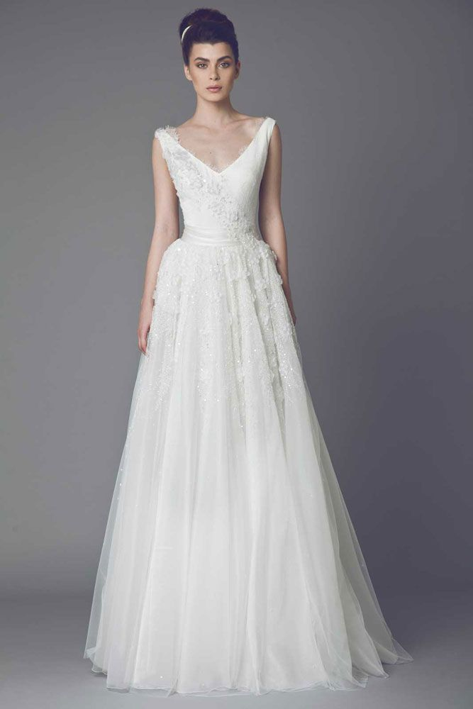 Acacia - V neckline princess cut embroidered Tulle gown with floral Organza embellishments and draped belt.