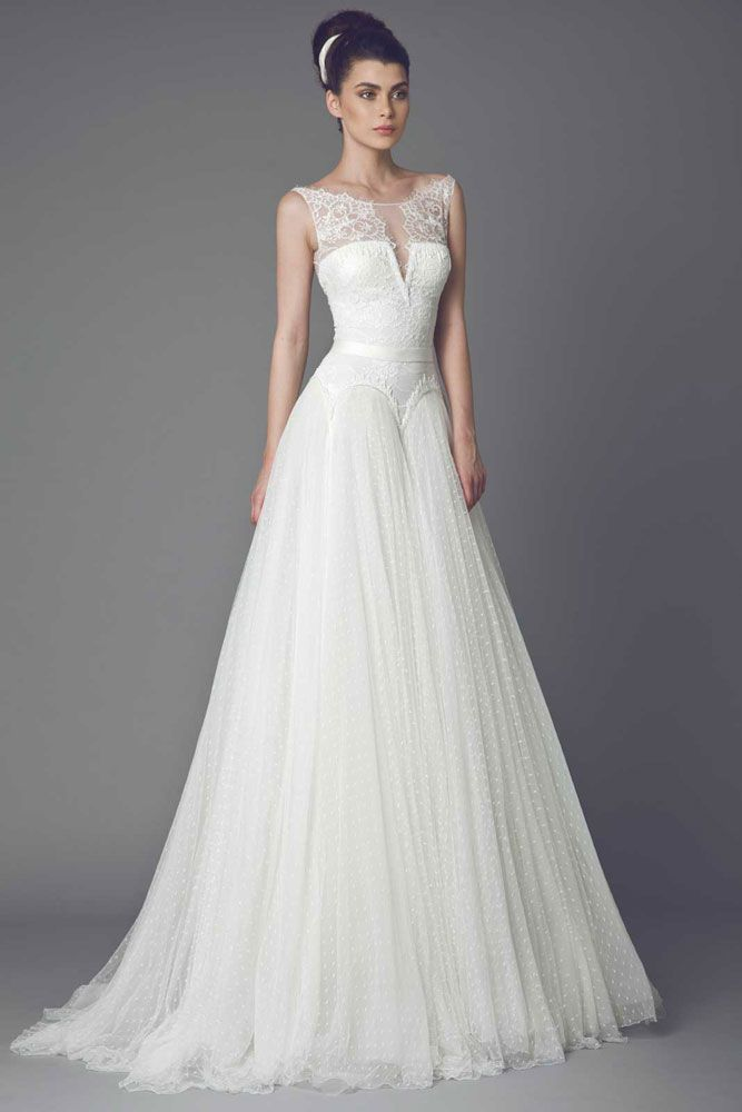 Bleuetta - Off White gown with Lace bodice, skirt in Tulle Point D esprit and belted waist, embellished with lace appliques.