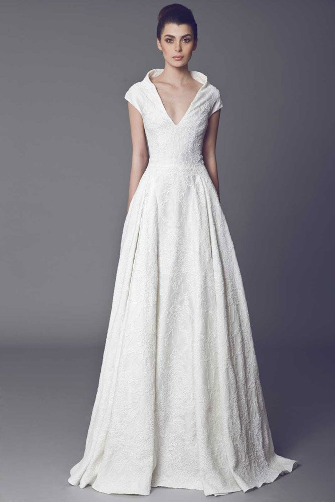 Arôme - Off White Silk Zibeline gown covered with Lace, with high collar.