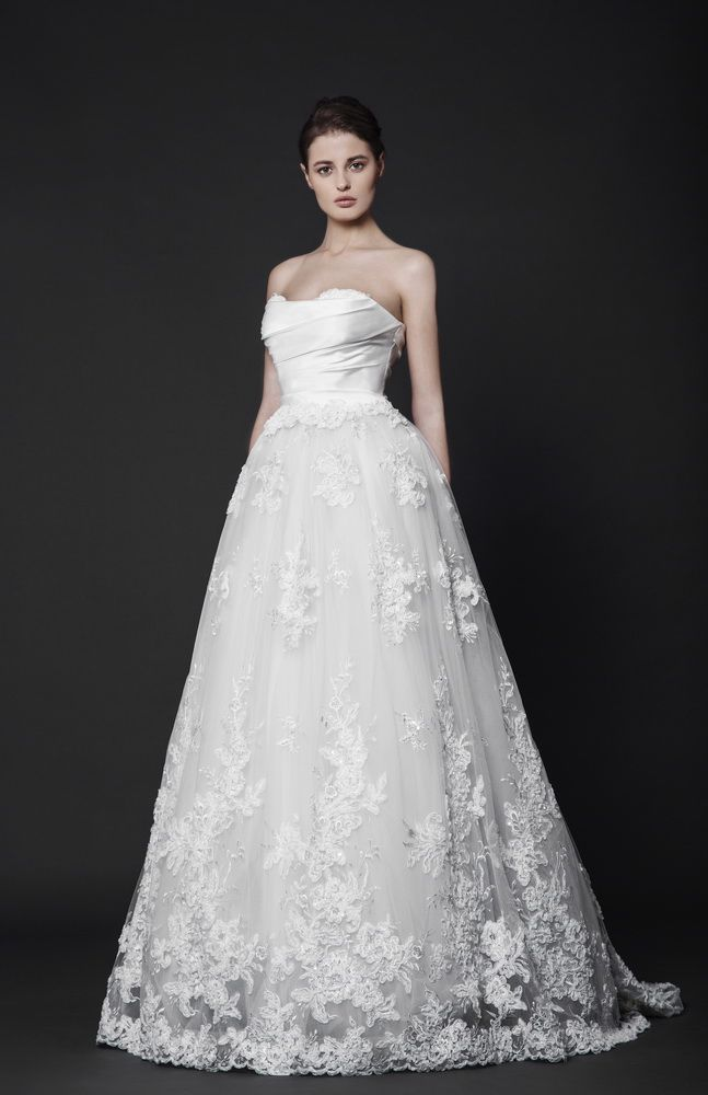 Off-White strapless ball gown with a Satin draped bust and a full, embroidered Tulle skirt finished with a scalloped hem.