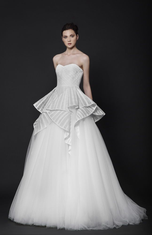 Off-White ball gown with a sweetheart shaped bust, featuring a Tulle skirt with Lace ruffles on the waistline, embellished with band detailing.
