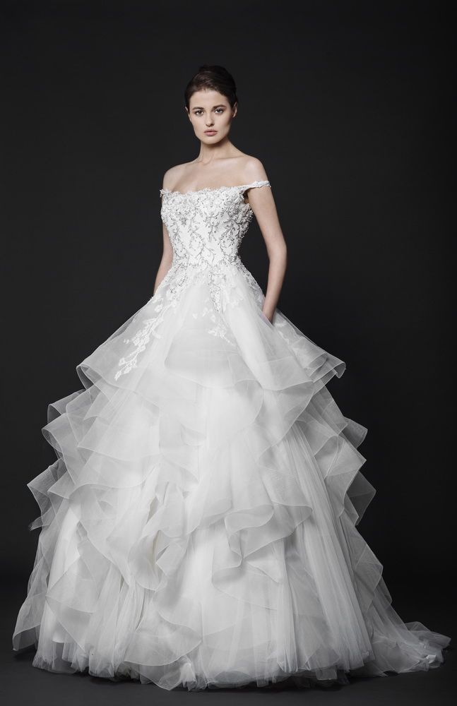 Off-White ball gown with an embroidered bodice and tank neckline, featuring a full ruffled Tulle skirt.