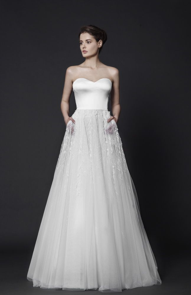 Strapless Off-White Ball gown with sweetheart shaped bust in Silk Satin and cascading crystal beading on the Tulle skirt.
