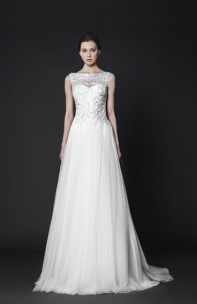 Off-White A-line Tulle gown embellished with Silk-thread embroideries on the sheer overlay bodice.