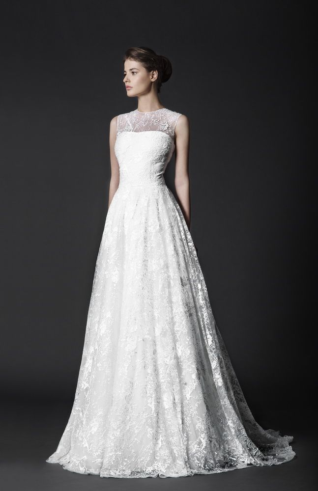 Off-White Lace Ball gown with delicate crystal embroideries and sheer overlay bodice.