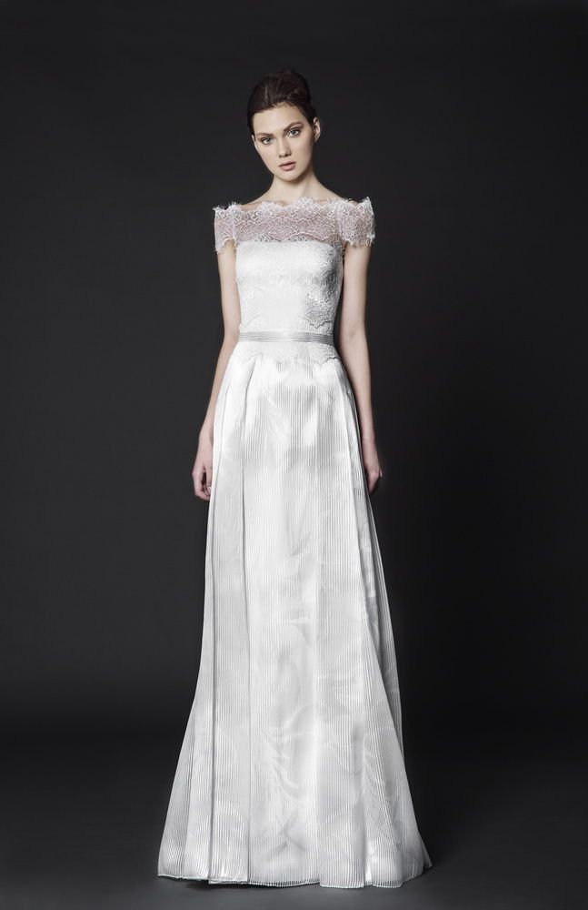 Off the shoulder floor-length Organza dress with a Lace overtop and box pleats on the skirt.
