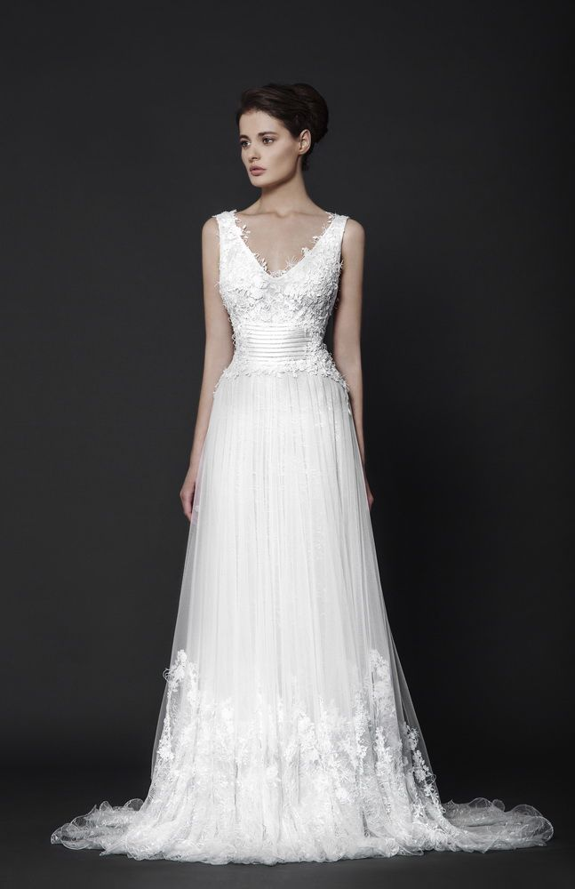 Off-White floor-length dress in Silk Tulle with Macramé and Lace appliques on the skirt and bodice, and illusion corset bands on the waistline.