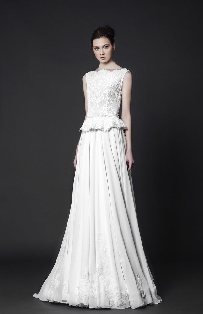 Off-White floor-length dress in Crepe Georgette with boat neckline, embroidered Lace bodice and a ruffled waistline.