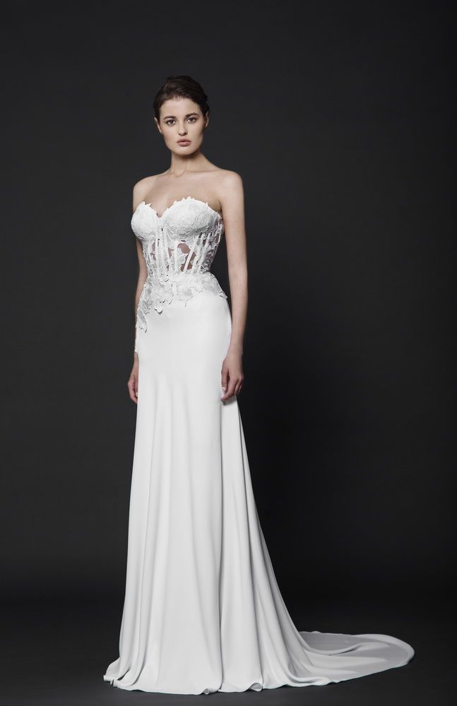 Off-White Moroccan Crepe gown with a sweetheart shaped bust featuring corseted wires and Lace appliques.