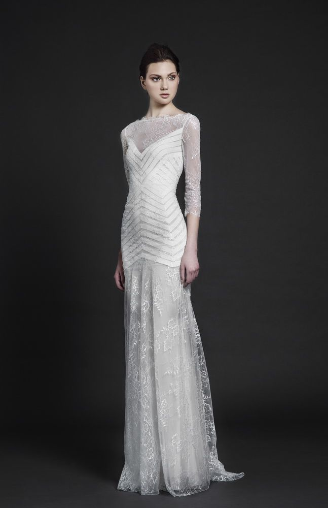 Three quarter sleeve Off White Mermaid gown in Lace, with symmetrical band pattern bodice.