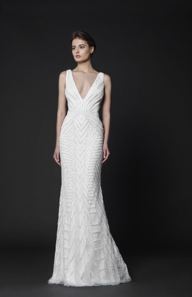 Off-White Lace dress with plunging V-neckline, featuring a geometrical crystal-bead pattern.