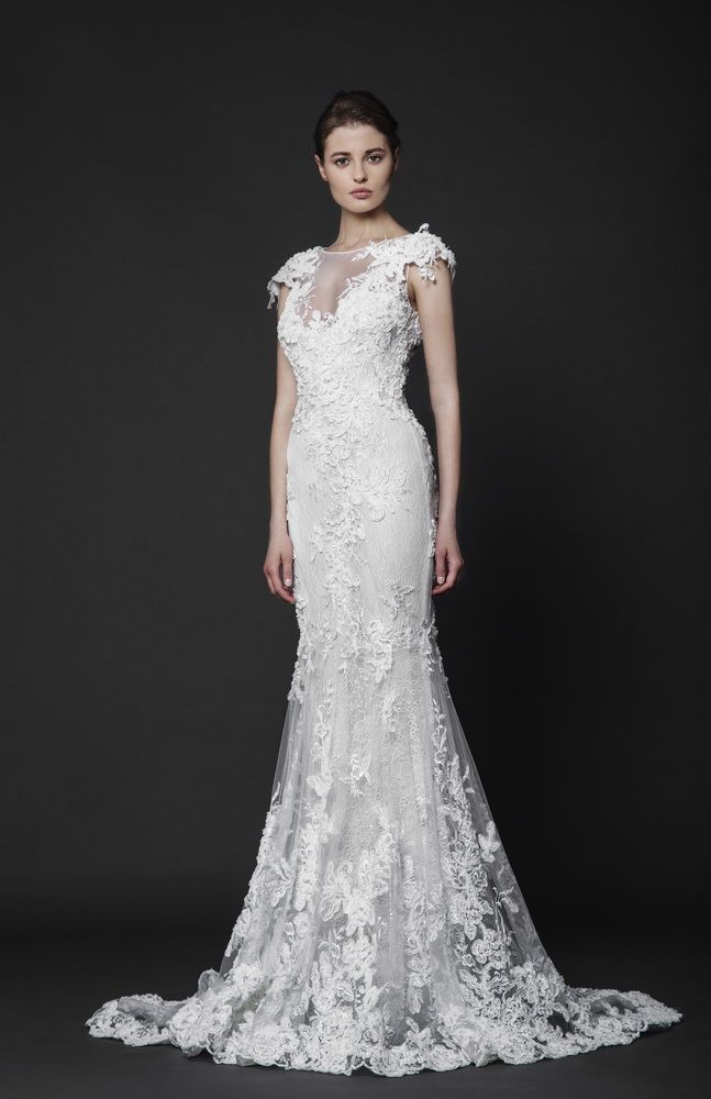 Off-White Mermaid Lace gown in embroidered Tulle, featuring cap sleeves and a sheer neckline.