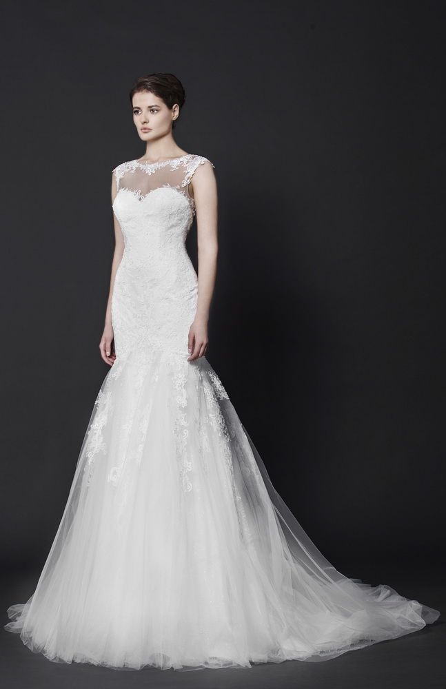 Off-White mermaid Lace gown with sheer neckline and a Tulle skirt, embellished with delicate Lace embroideries.