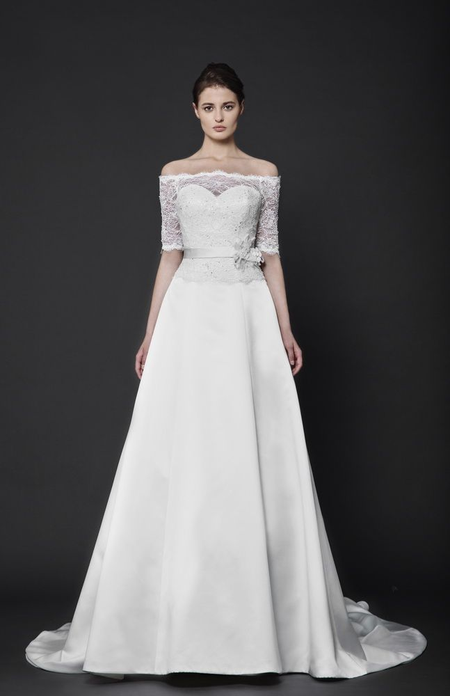 Three quarter sleeve off the shoulder Satin Duchesse A-line gown with a Lace overlay top and an embellished belt.