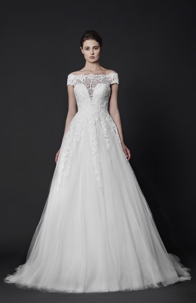 Off the shoulder Tulle gown with sweetheart shaped bust and Guipure embellishments.