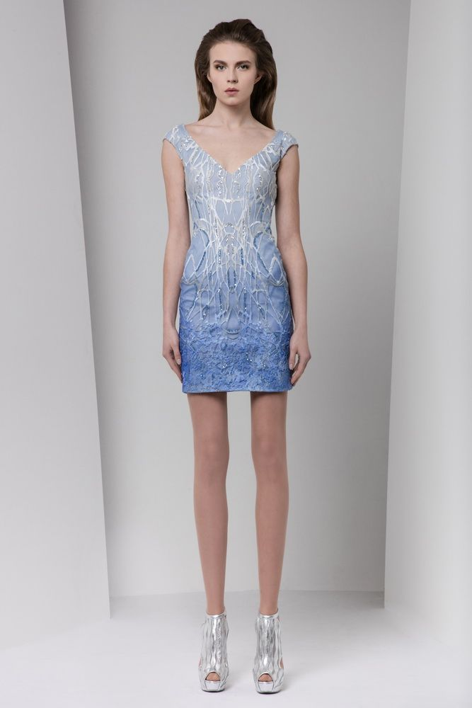Short fitted light blue ombré dress featuring crystal and silk embroideries, with V-neckline and cap sleeves.