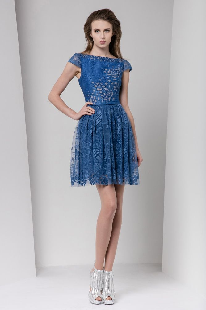Steel blue gazar cloqué short dress with boat neckline and cap sleeves, featuring cutout embellishments on the bust and a gathered silk-embroidered skirt.
