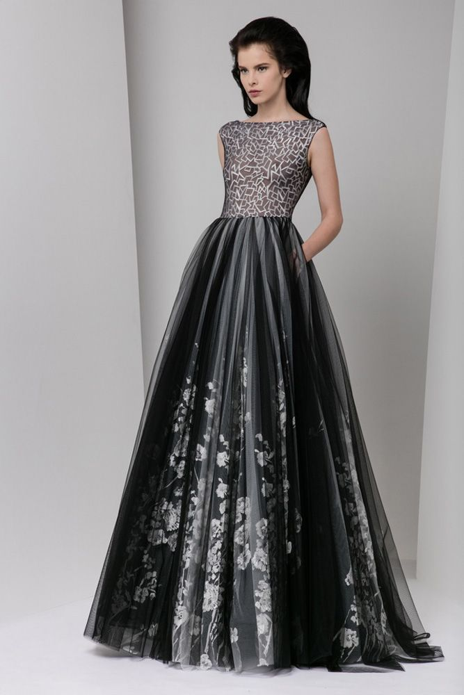 Black tulle evening dress with white embroidered silk embellishments, bateau neckline, a full gathered skirt and pockets.
