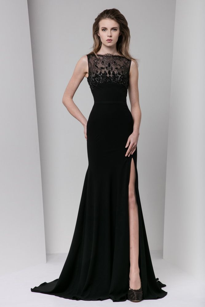 Black mermaid floor-length dress in Moroccan crepe with a lace, crystal-embroidered bateau neckline and a side slit.