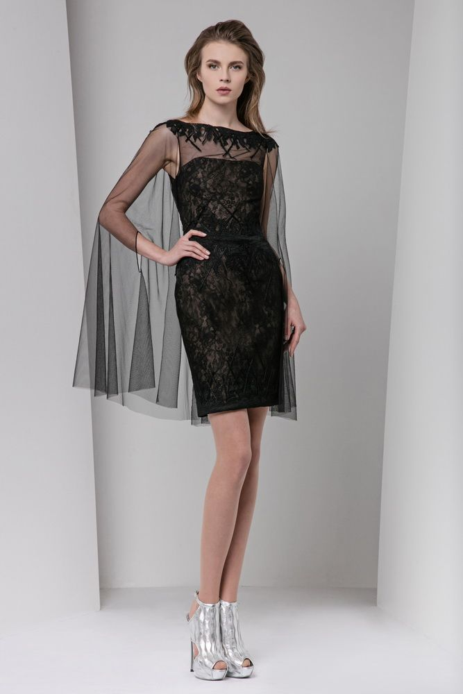 Short black lace dress with organza cloqué appliques, featuring an embellished neckline and a tulle cape.