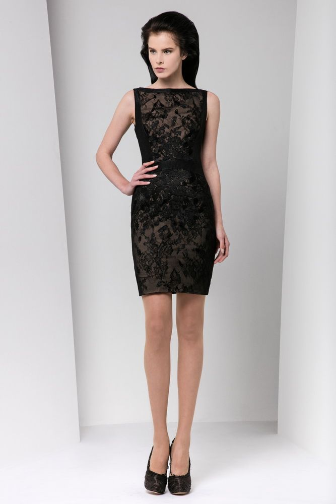 Short fitted black lace dress with bateau neckline, corseted with organza cloqué bands and embellished with silk embroidery.