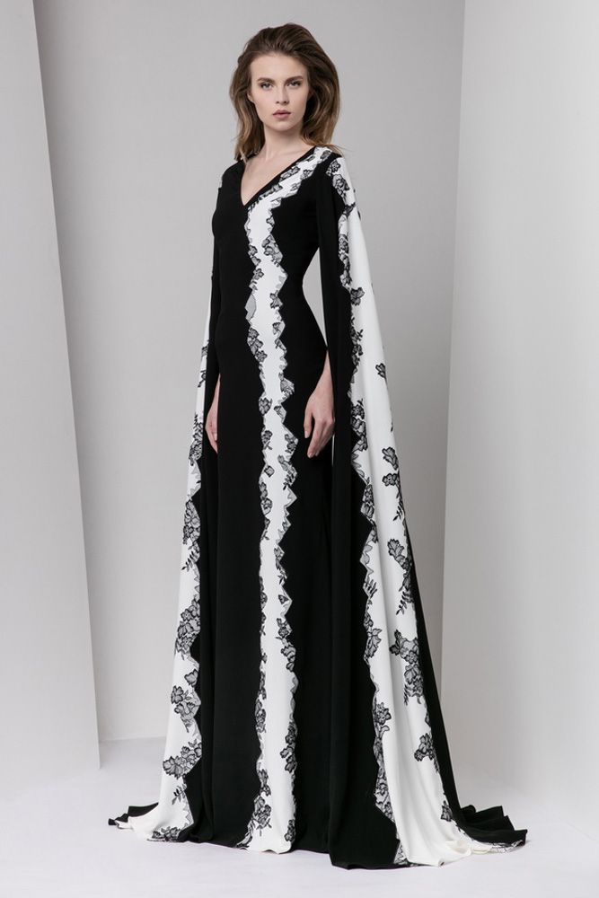 Black and white sheath Moroccan crepe dress featuring a V-neckline, floor-length sleeves and lace embellishments.