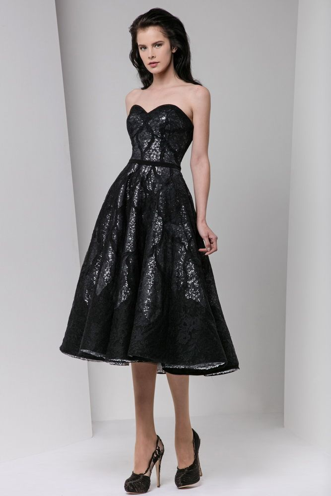 Black tea-length sweetheart sequined dress covered in layers of Moroccan crepe and lace.