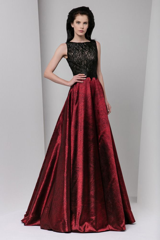 A-line evening dress featuring a black, silk-embroidered bodice and a burgundy Jacquard lamé skirt.