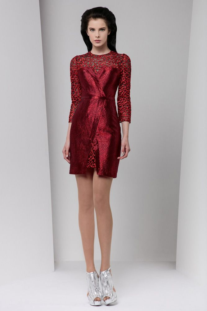 Short, ¾ sleeve silk embroidered burgundy dress covered with a Jacquard lamé wrap and a belt on the waistline.
