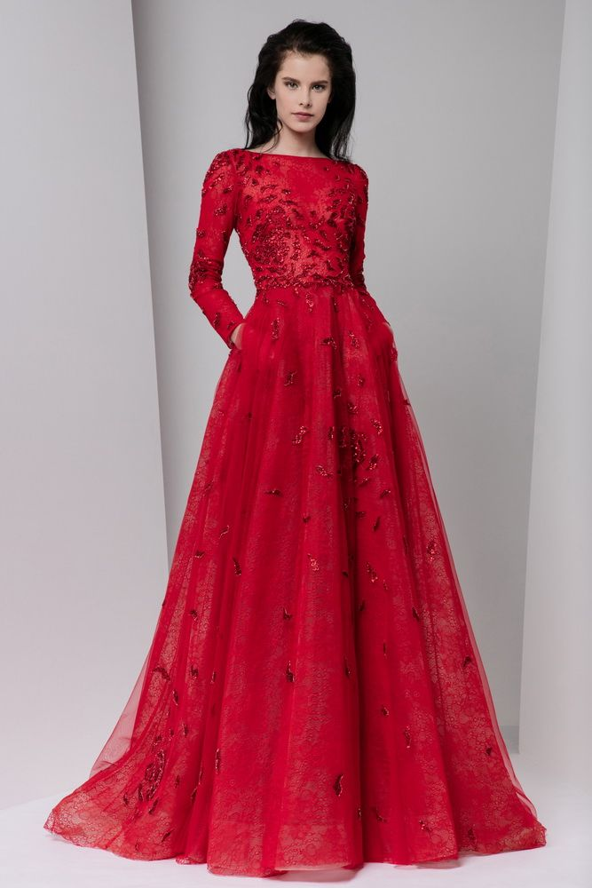 Long sleeve crimson A-line lace dress with bateau neckline, a full gathered skirt and pockets, embellished with touches of crystal embroidery.
