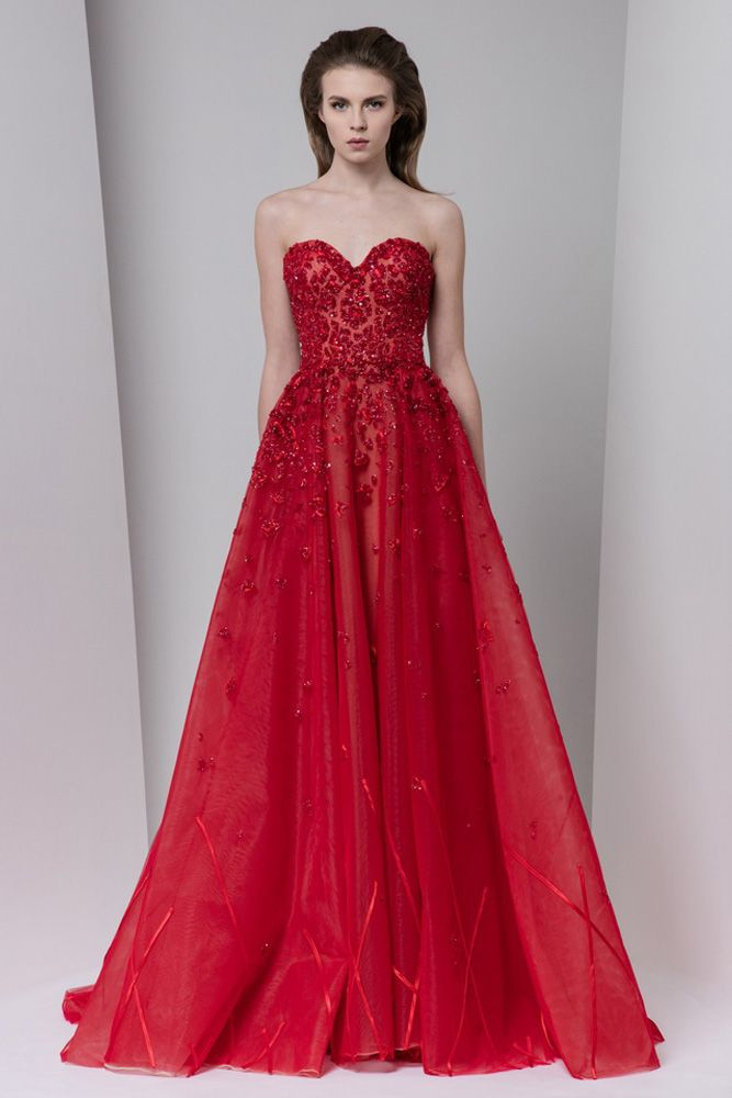 Crimson sweetheart tulle evening dress with an overskirt, embellished with crystal embroideries and satin bands.