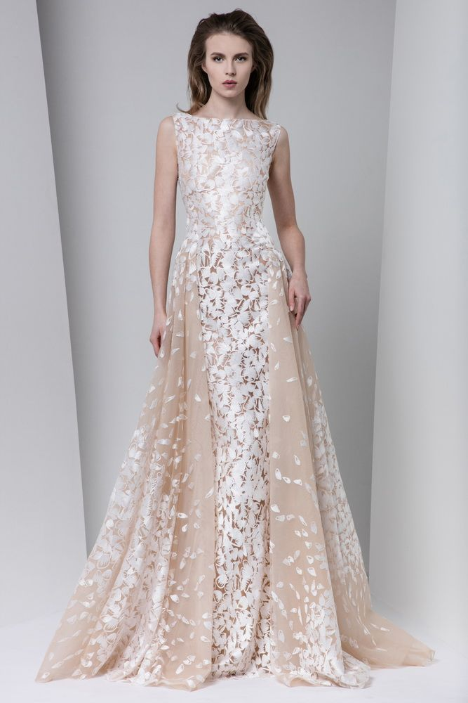 Sheath silk-embroidered blush evening dress with bateau neckline and a two-side gathered overskirt.