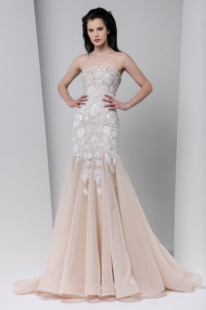 Blush strapless mermaid-cut dress with white silk embroidery and a gathered tulle skirt.