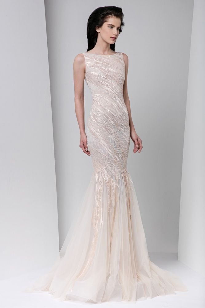 Blush mermaid-cut tulle dress with white silk embroidery and a boat neckline.