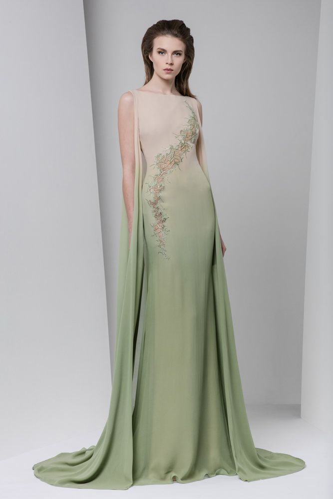 Beige to olive green ombré georgette cape dress featuring a curved cutout embellished with foil macramé and a boat neckline.