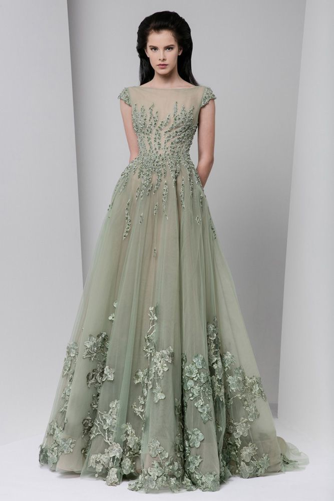 Olive green A-line tulle dress with cap sleeves and a full gathered skirt and pockets, embellished with touches of crystal embroidery and silk flower appliques.