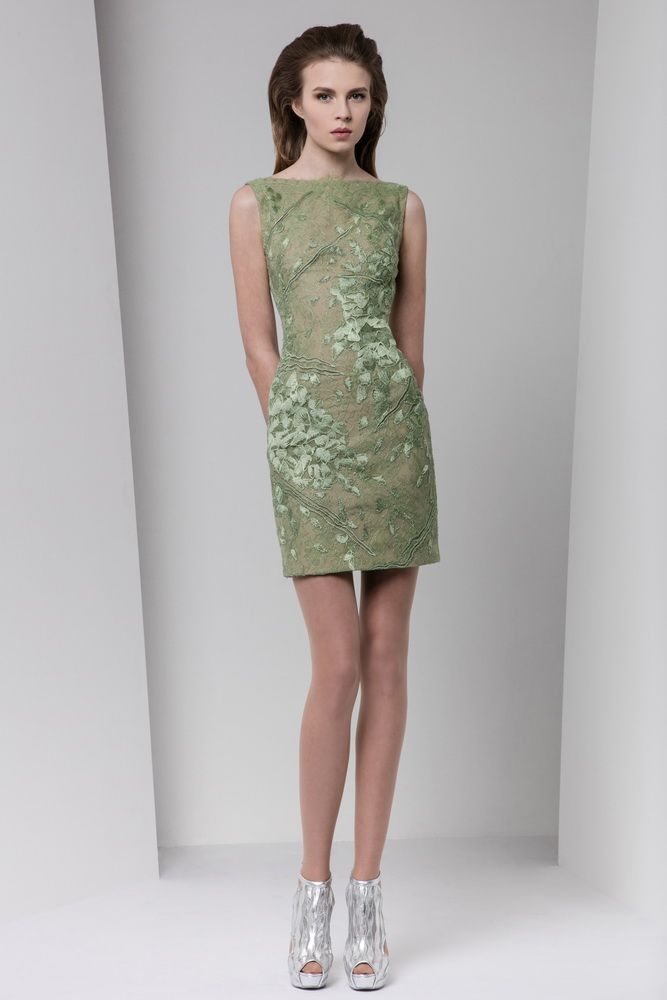 Short fitted olive green dress with applique silk embroideries and cutout embellishments, bateau neckline.