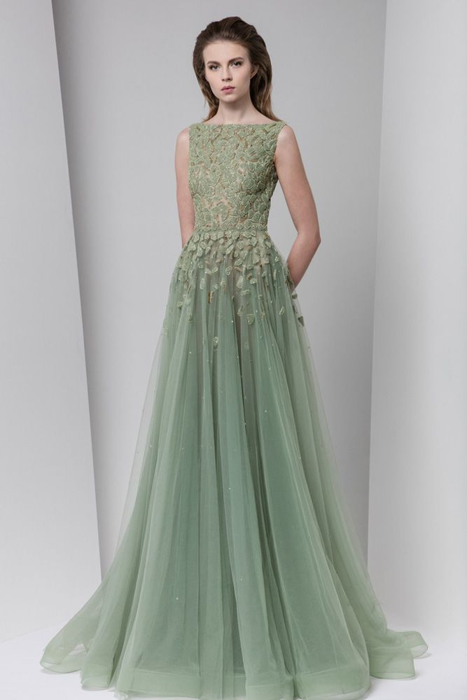 Olive green tulle dress with bateau neckline, fully embroidered bodice and a gathered skirt finished with a Crinoline hemline.